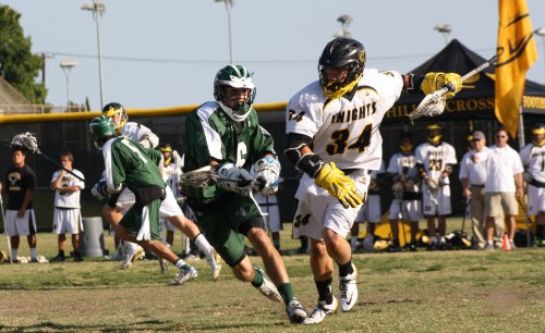Foothill Knights Lacrosse Middie Chris Cole drives on Coronado Islanders LSM Jonnie Poe in 2009. Photo by LaxBuzz