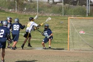 Foothill JV Lacrosse Attack #12 Andrew Dainko Scoring against Trabuco Hills