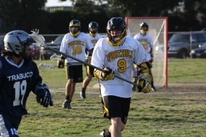 The Foothill Knights JV Lacrosse Defense, shown here with Defenseman #9 Connor Cummins and Middie #18 Brenton Bader, will need to slow down La Costa Canyon's potent offense on Saturday