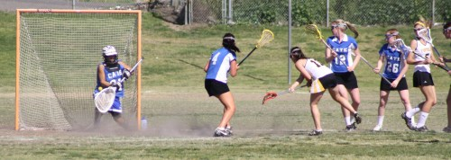 Foothill Varsity Girls lacrosse attackers started getting shots by Cate Schools outstanding goalie as the second half progressed.