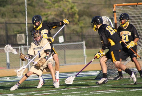 Foothill Defenseman #8 Brad Gustafson stops La Costa Canyon attacker as #19 Chance Cooper closes in....