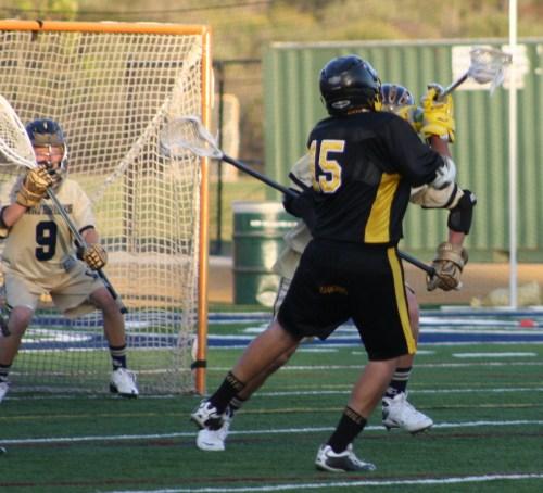 Foothill JV Lacrosse attack #15 Daniel Castillo finds an opening in the Mavericks defense....