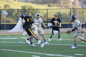 Foothill JV Lacrosse middie #14 Travis Mann ties the score against La Costa Canyon at 4-4 with 9:42 to go in the 4th quarter.