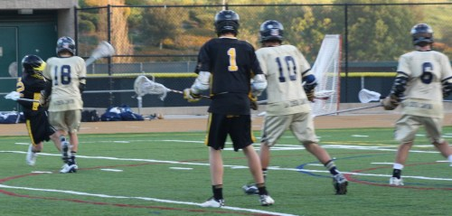 Foothill JV Lacrosse middie #22 Josh Peterman fires in the Knights 6th goal of the game....