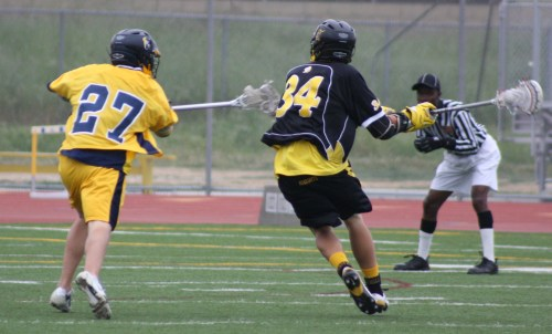 ...Foothill Knights Lacrosse middie #34 Chris Cole preparing to shoot against the El Toro Chargers Thursday afternoon...