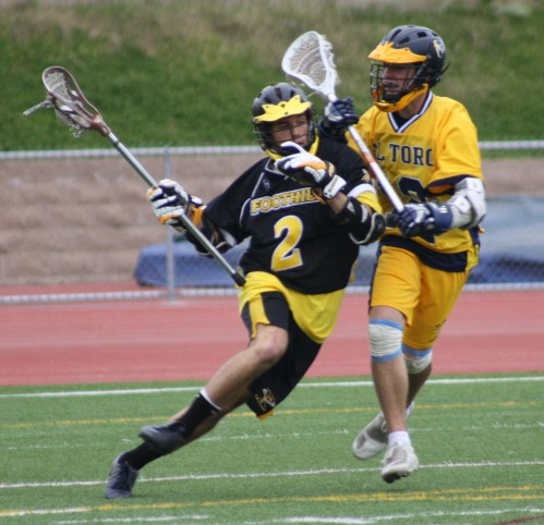 Foothill Knights Lacrosse middie #2 Patrick Douglas driving on El Toro defense in 4th quarter...