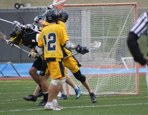...and scoring (#2 Patrick Douglas) the sixth and deciding goal (in lower left of net)...