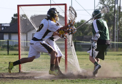 ...and point blank from the crease. (#9 Bobby Braun, Photo by LaxBuzz)