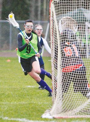Issaquah High School junior Sydney Lee scores a goal against Eastside Catholic on April 2. Courtesy of Issaquah Youth Lacrosse