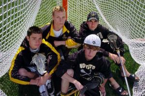 Jake Caliguire, (L), Cody Dawson, (back middle), Conor Breckenridge (back right), and Griffin Griggs (front right), sit for a portrait before practice at Novato High on Thursday, April 16, 2009. The four teammates grew up in the Novato Lacrosse Club and now star for the Novato High Hornets lacrosse team. (IJ photo/Jeff Vendsel)
