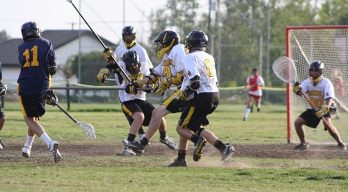The Foothill Knights JV Lacrosse defense and goalie Zack Schenker did not allow El Toro to score in the remaining 18 minutes and 50 seconds of the game....(Photo by LaxBuzz)
