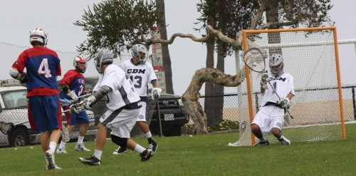 Corona del Mar goalie Andrew Noto makes great save of St. Ignatius attack Will Fredericks shot in first quarter Saturday. Photo by LaxBuzz