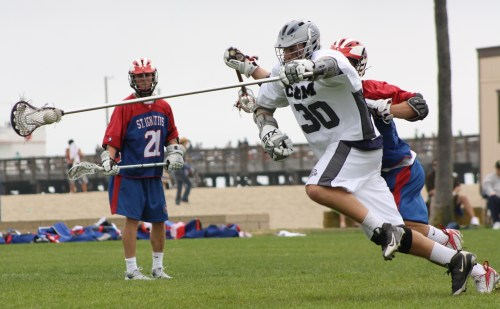 Corona del Mar Lacrosse defenseman J.D. Abbott played tough against St. Ignatius attack on Saturday. Photo by LaxBuzz