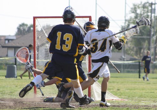 Foothill Middie Chris Cole scores against El Toro in the third quarter...Photo by LaxBuzz