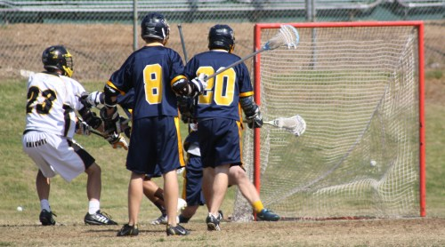 ...Middie Cooper Pickell tied score at 3-3 in the first quarter against El Toro (Photo by LaxBuzz)
