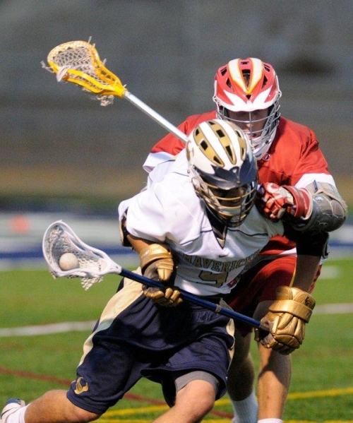 La Costa Canyon's Alex Pardieu, left, and Cathedral Catholic's Alex Pascale battle for the ball during the Mavericks' victory in the CIF San Diego Section boys lacrosse semifinals. (Photo by John Koster - For the North County Times)