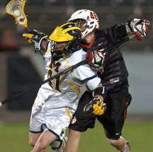 David Rogers (left) scored his first career hat trick with all three goals coming in the midst of a second half comeback that gave Michigan a 12-11 victory over Chapman in MCLA championship game in Denver.  The win gave the Wolverines their second straight undefeated season and 40 consecutive victories.