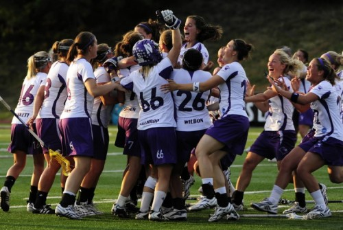 The Northwestern women's lacrosse team celebrates on the field following a 21-7 victory over North Carolina. (Algerina Perna/Baltimore Sun/MCT / May 24, 2009)