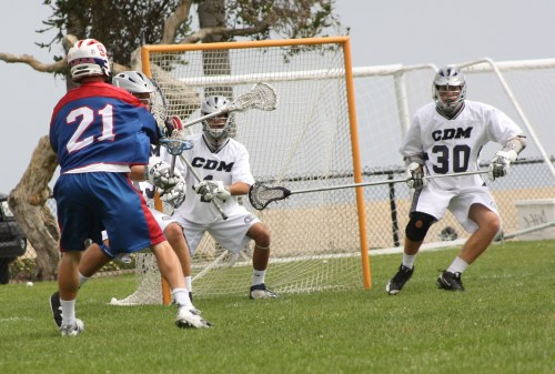 St. Ignatius Lacrosse attack Carlton Fisher (3 goals + 1 assist) scores in the first quarter against Corona del Mar. Photo by LaxBuzz