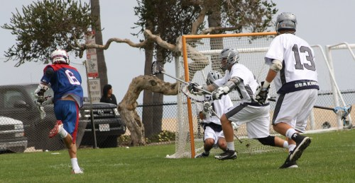 St. Ignatius middie Jack Farr scored early in the first quarter against Corona del Mar to put Wildcats in lead...(Photo by LaxBuzz)