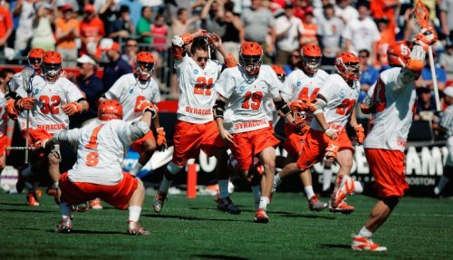 Cody Jamieson (right) scored the overtime winner as Syracuse rallied to beat Cornell in the NCAA title game.