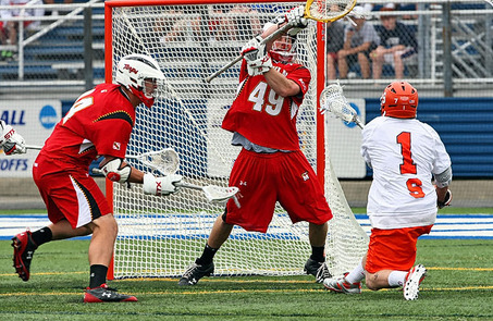 Pat Perritt of the Syracuse University men's lacrosse team fires shot past Maryland goalie Jason Carter during SU's 11-6 quarterfinal victory Saturday. Dick Blume/The Post-Standard
