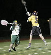 Kyle Riddle, above right, senior attackman for Amador Valley High boys lacrosse team, has been selected as a High School All-American by a California Interscholastic Federation panel.