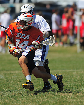 Stephen Kelly scored two goals and 11 of 16 faceoffs to help lead FCA (Md.) to a 10-9 overtime victory over For Love of the Game (N.Y.) in the US Lacrosse U-15 boys' championship game.