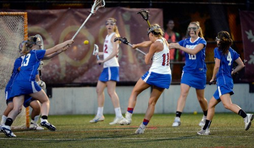 Cherry Creek Blair Sisk (11) takes a shot on goal against Centaurus during their lacrosse state championship game. (Photo By John Leyba/The Denver Post)