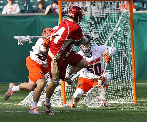 Denver Men's Lacrosse Middie Eric Adamson scoring against Syracuse on May 25. Photo by  Dick Blume | dblume@syracuse.com