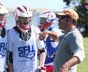 Coach Greg Angilly talks to players during practice with the Alcatraz Outlaws lacrosse team on Sunday, June 2, 2013, in Corte Madera, Calif. The Alcatraz Outlaws is a Bay Area club lacrosse team for high school boys looking to gain exposure with college programs. (Frankie Frost/Marin Independent Journal)