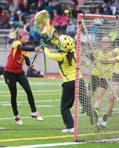 Oregon goalkeeper Becca Katzen saves a shot by USC's Caroline Federighi in Sunday's NCAA Seatown Classic women's lacrosse exhibition at Issaquah High School. Photo by © Sue Larkin for Lacrosse Magazine
