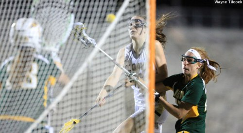 Junior Elizabeth Landry scored four goals while sophomore Ellie Delich added another three to lift UC Davis to an 11-9 overtime win over Siena in non-conference women's lacrosse action at Aggie Stadium Monday evening. Both players scored in the extra frame to help the Aggies remain undefeated for the year.  UC Davis moves to 4-0 overall. The Saints slip to 1-4.  Landry scored one goal in the first half, two in the second, then her fourth on the opening possession of the overtime period. She also picked up a game-high six draw controls. Delich netted back-to-back midway through the first half then added an insurance goal in the 63rd minute. Freshman Melissa Kellan provided another two goals while Meghan Jordan and Morgan Sissler each netted one. Senior Carly Voris had an assist, three draw controls and five ground balls.  For Siena, sophomore Sarah Croutier shot 4-for-5 while Alyssa Treanor hit another two. Junior midfielder Julia Sirianni had a goal with a team-leading four draw controls.  The game ran in streaks for either team before settling into a 9-9 tie at the end of regulation. Croutier and Treanor sparked the Saints to a 2-0 lead in the first nine minutes before Delich's consecutive scores led a 3-0 Aggie comeback. Croutier responded with two goals amidst a run of four unanswered Siena goals to set the board at 6-3 through the 28th minute. However, Kellan's eight-meter goal in the 29th and Jordan's unassisted drive with five seconds left in the first period evened the tally at 6-6 at the break.   The ebb-and-flow pattern continued into the second as Landry's two goals extended UC Davis' scoring stretch to five unanswered, giving the Aggies an 8-6 lead through the 39th minute. Croutier's four goal halved the deficit to one at the 10:30 mark in the second, then turnovers by either side halted the scoring before Kellan's second-chance goal made it 9-7 in the 49th minute. UC Davis suffered a tough break minutes later when a goal came off the board in the 51st: Delich had found Voris cutting through the eight-meter area, and Voris converted the pass, but the shot was disqualified after a routine stick check. The lead remained at two, and Siena gained possession.  The Saints closed the gap to a 9-8 when Treanor converted an eight-meter chance in the 55th, then Sirianni equalized when she converted an Erin Mossop assist with less than four minutes remaining. UC Davis had three chances to take the game in regulation. Junior Sara Quero drew a charge when Croutier attempted a crease roll -- a play on which she had scored twice before -- with 2:40 remaining. The Aggies quickly transitioned to the offensive end, but Siena freshman goalie Samantha DePasquale came up with a big save on an ensuing eight-meter attempt.
